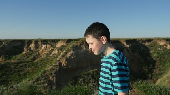 Thumbnail for Small Boy Goes Along the Hilly Black Sea Coast in Summer in