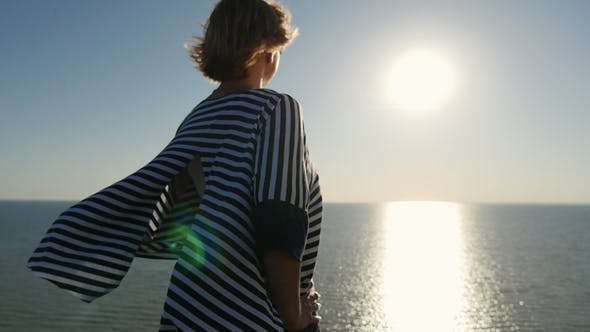 Thumbnail for Refine Blond Woman Stands and Enjoys the Sunset on the Black Sea Shore