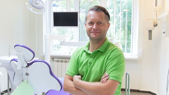 Thumbnail for Footage of Handsome Male Dentist Posing in Dentist Office at Modern Clinic