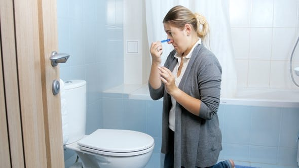 Thumbnail for Footage of Young Woman Closes Her Nose with Clothesping Before Cleaning Toilet
