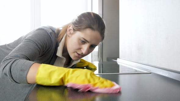 Thumbnail for Footage of Young Woman Polishing and Cleaning Kitchen Countertop