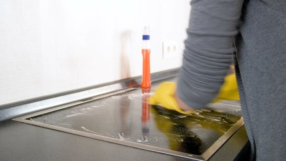 Thumbnail for Housewife in Yellow Rubber Gloves Rubbing and Cleaning Stained Electric Stove in Kitchen