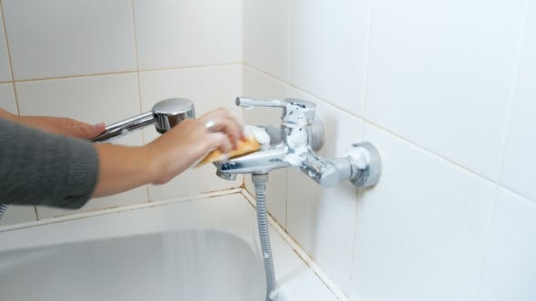 Thumbnail for Young Woman Washing Water Tap in Bathroom with Cleanser and Sponge