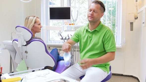 Thumbnail for Dentist Wearing Protective Surgical Mask and Looking at Patient