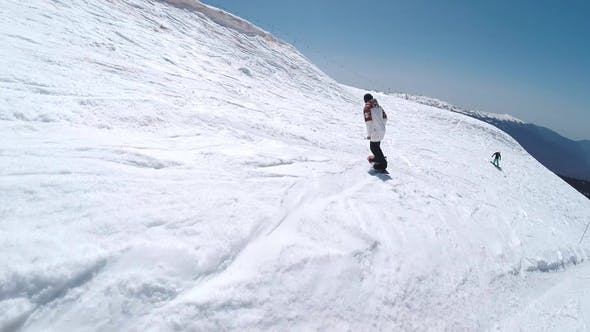 Thumbnail for Snowboarder Slides Down on Sunny Day at Rosa Khutor
