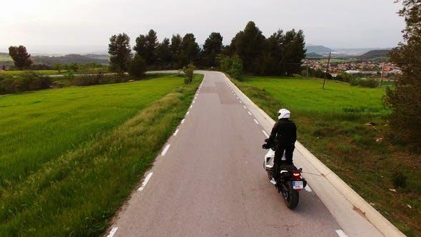 Thumbnail for Motorcyclist Driving his Enduro Motorbike on a Curvy Road
