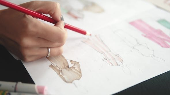 Thumbnail for Designer of Clothes Makes an Outline of Clothes with a Felt-tip Pen. Female Hands