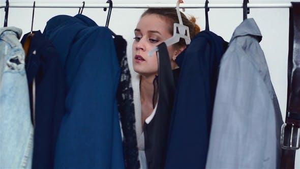 Thumbnail for A Girl Choosing Clothes at Home Wardrobe