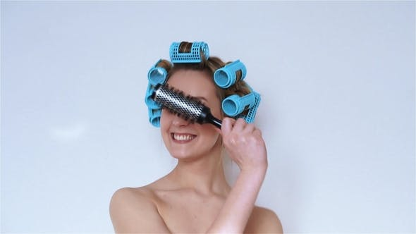 Thumbnail for Funny Girl in Hair Curlers Singing in a Hairbrush