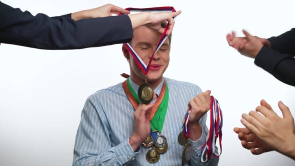 Thumbnail for Man Winner with Medals on a White Background