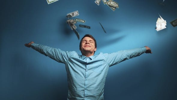 Thumbnail for Excited Man Standing with Arm Folded in Money Rain