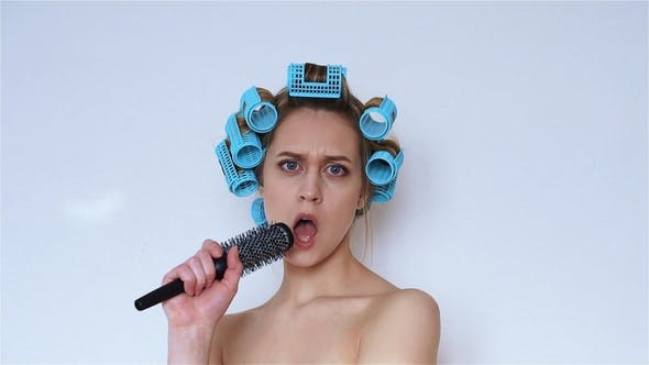 Thumbnail for Woman in Hair Curlers Singing in a Hairbrush