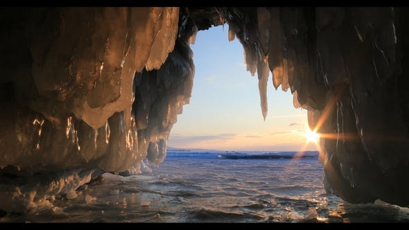 Thumbnail for Winter Baikal. Ice Cave with Icicles at Sunset.