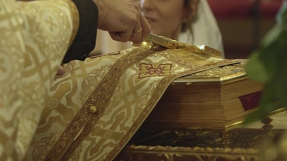 Thumbnail for Couple Gives Vows Before God Putting Their Hands on the Bible and Swear Allegiance for Life All the