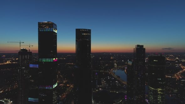 Thumbnail for Aerial View of Skyscrapers and City Skyline at Morning Twilight