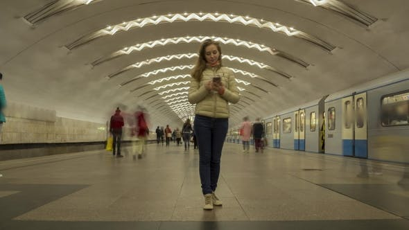 Thumbnail for Woman Standing Still in Metro Station and Using Mobile Phone