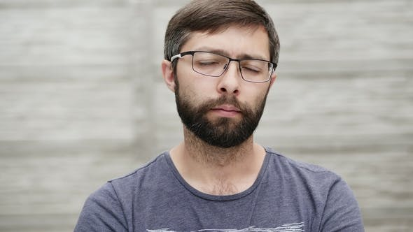 Portrait of a Thirty-five Year Old Man with a Beard Wearing Glasses