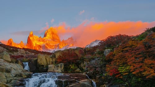 View of Mount Fitz Roy and the Waterfall in the National Park Los Glaciares National Park at Sunrise