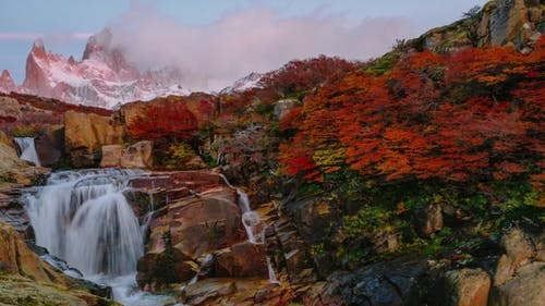 View of Mount Fitz Roy and the Waterfal in the National Park Los Glaciares National Park at Sunrise