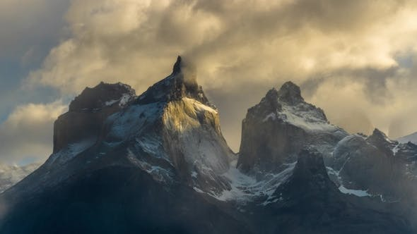 View of Torres Mountains in the Torres Del Paine National Park During Sunrise. Autumn in Patagonia