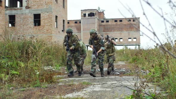Group of Soldiers Running with Weapons