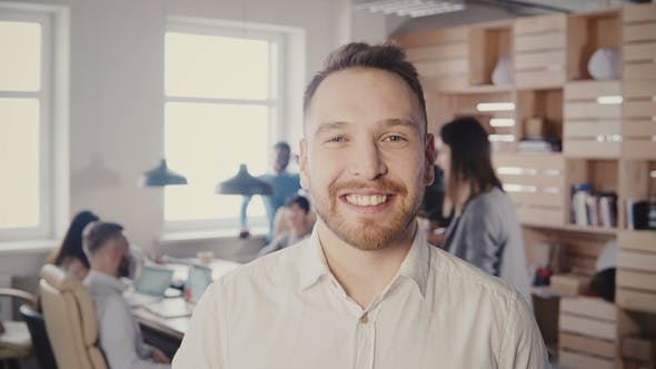 Thumbnail for Successful Caucasian Businessman Looking and Smiling at Camera in Modern Trendy Office, People Work