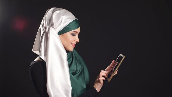 Thumbnail for Portrait of Happy Muslim Woman Using Mobile Phone