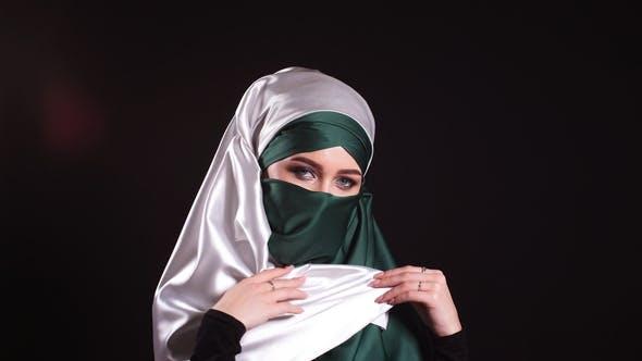 Thumbnail for Portrait Beautiful Muslim Girl in Hijab Looking in Camera