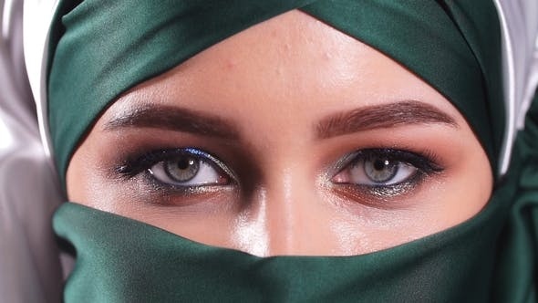 Thumbnail for Portrait of an Arabic Young Woman with Her Beautiful Eyes in Traditional Islamic Cloth Niqab