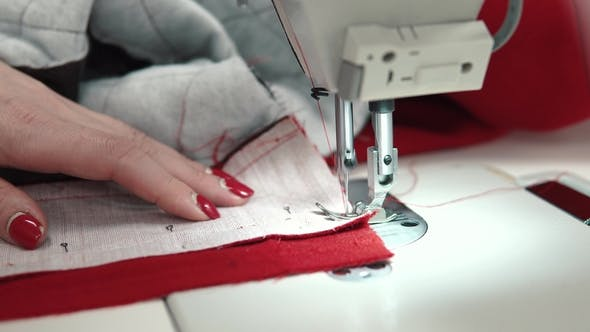 Thumbnail for Woman Sews on a Sewing Machine. Female Hands