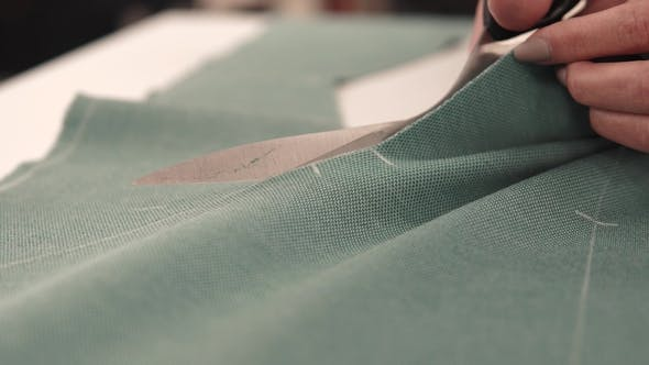 Thumbnail for Seamstress Cuts the Fabric with Scissors. Hand Seamstress