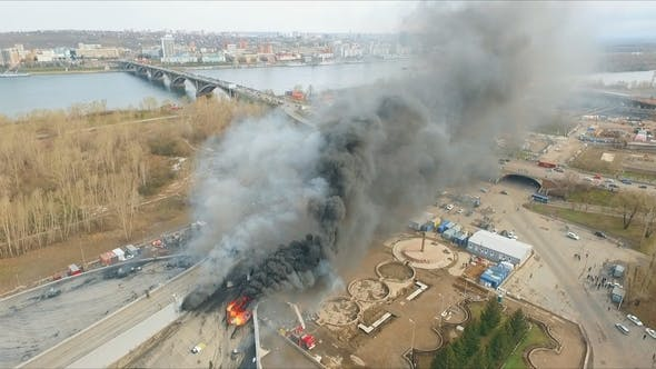 Cover Image for Aerial View of the Brave Firefighters Risking Their Lives Extinguish a Large Fire