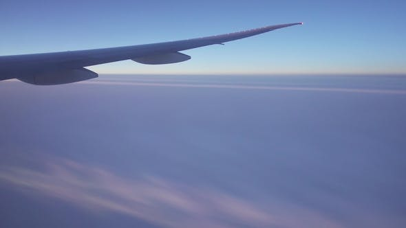 Thumbnail for Looking on Wing and Fumes of Flying Airplane