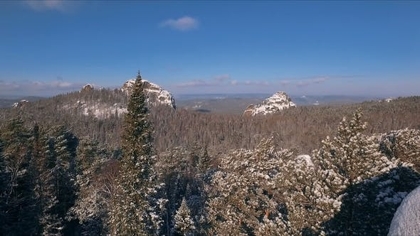 Thumbnail for Aerial View Winter Snowscape with Forest, Trees and Snowy Cliffs. Blue Sky. Winter Landscape
