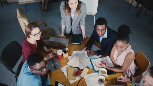 Top View Teamwork at Development Company Office. Multiethnic Creative Team Discussing Real Estate