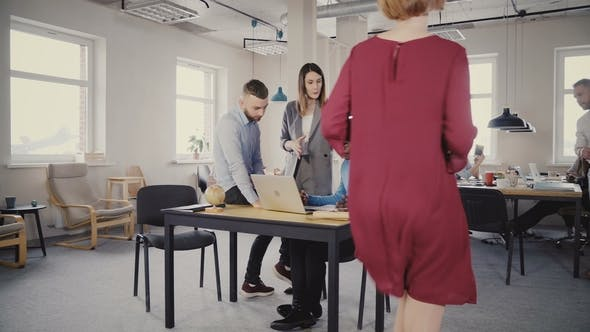 Thumbnail for Confident Woman CEO Helping Mixed Ethnicity Male Colleagues, Looking at Laptop Screen. Teamwork in