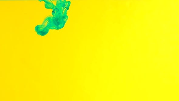 Thumbnail for Ink in Water. Green Paint on Yellow Reacting in Water Creating Abstract Cloud formations