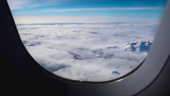 Thumbnail for Flying Over Mountains, View From Airplane Porthole