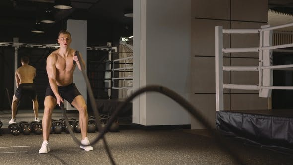 Man Working Out with Ropes