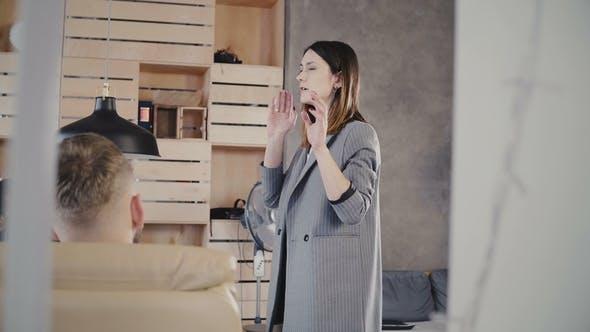 Thumbnail for Female Leader Speaking at Office Team Meeting
