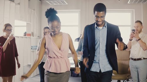 Happy African American Friends Doing Ethnic Dance at Office Party
