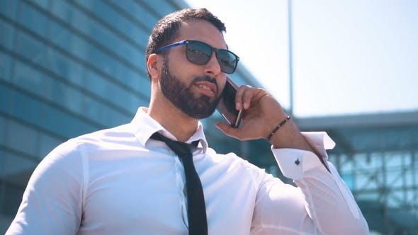 Thumbnail for Businessman Talking By Smartphone