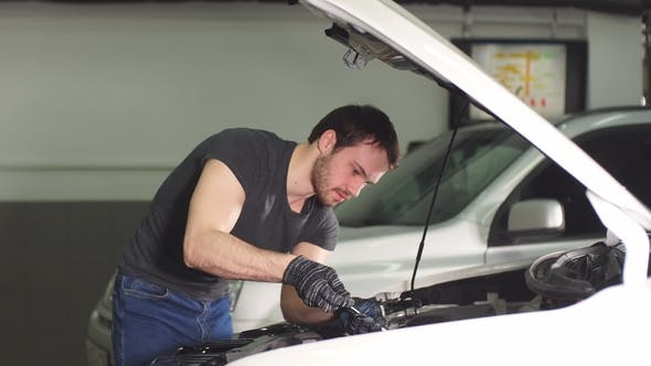 Thumbnail for Auto Mechanic Testing Electrical System on Automobile.