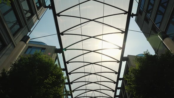 Thumbnail for Glass Canopy Between Buildings To Protect From Rain and Sun. Comfort in Modern Construction