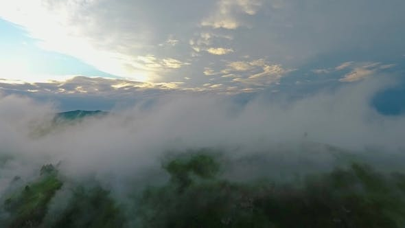 Cover Image for Aerial View of the Katun River and Hills During the Fog After the Rain. The Republic of Altai