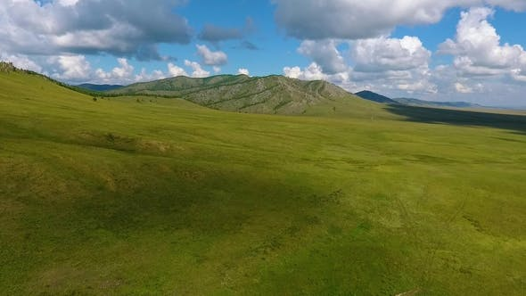 Thumbnail for Green Meadows, Hills in the Distance and Cloudy Sky in the Republic of Khakassia