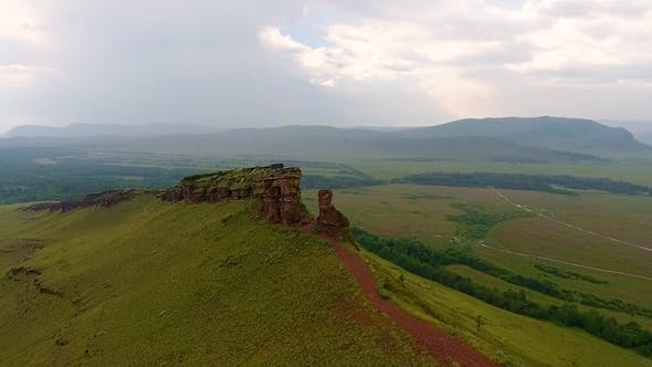 Thumbnail for Aerial View of the Green Fields of Mountain Range Sunduki before the Storm
