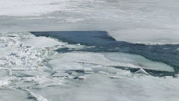 Thumbnail for Cracked Ice Floating on the River in Spring Time