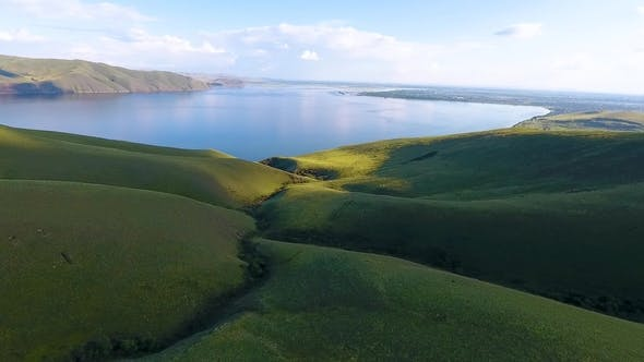 Thumbnail for Aerial View of the Green Hills, Cloudy Sky and the Yenisei River in the Republic of Khakassia