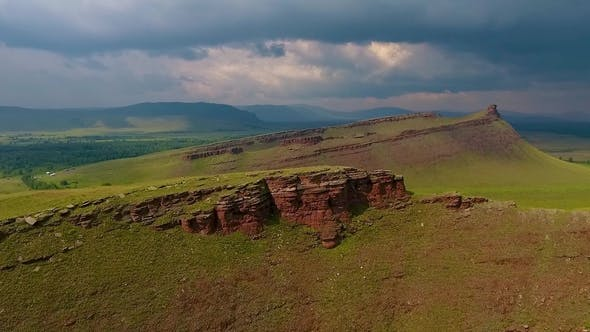 Aerial View of the Green Fields of Mountain Range Sunduki before the Storm